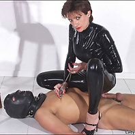 Latex catsuit mistress trampling