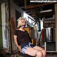 Ilona chair-tied ballgagged tit-grabbed