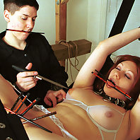 Tortured with wax, shaved, and beaten by her lesbian mistress.