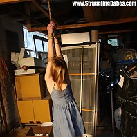 Bound and heavy struggling girl controlled by girl