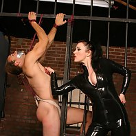 Horny domina chains and tortures a sudmissive stud