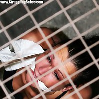 Dutch brunette on a string tightly cleavegagged held in basement