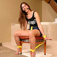 Auburn haired babe Angel Corte getting gagged and tied up on a chair