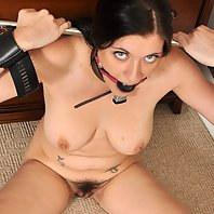 Beautiful Brook Scott is placed in spreader bars and gagged