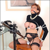 Tied and tormented busty mature