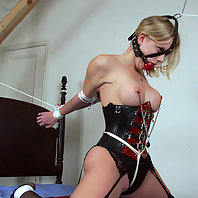 Hogtied hottie hangs helpless.