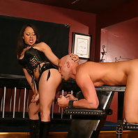 Horny Mistress Annie Cruz makes her slave mouthfuck her strap on cock and later crams his anal