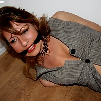 Eve hogtied cleavegagged struggling on the floor