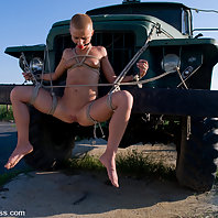 Exotic girl in outdoor BDSM.