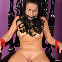 Busty raven haired slut tied up on a throne
