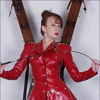 Red rubber outfit milf dominatrix