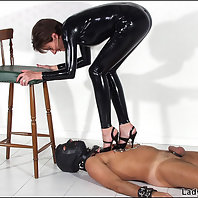 Latex catsuit domina tramples slave