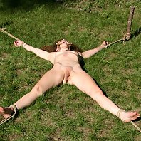 Small titted slave Cindy gets tied up and punished in the backyard
