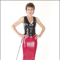 Rubber top and skirt dominatrix