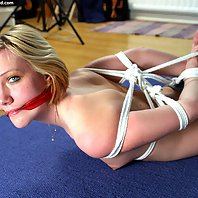 hogtied and both ballgagged and cleave gagged.,Stina is topless and tied up in her jeans. She is the