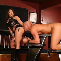 Fierce dominatrix Annie Cruz gets dirty and fucks her slave with a strap on and later rides his dick