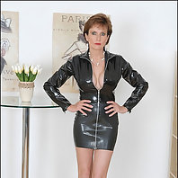 Rubber clad mature with long legs