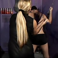 BDSM Mistress Nicolette restrains her slave to a swing and gags him and hurts him real bad live