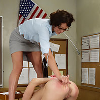 Teacher whips, spanks, and strap-on fucks her student in class