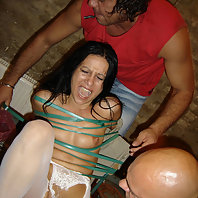 Check out this submissive lady as she gets bound and tortured by two macho guys in this BDSM story l