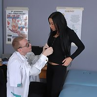 Scared brune examined by a male doctor