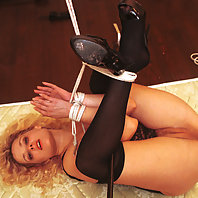 Tina is tied and suspended in various painful ways.