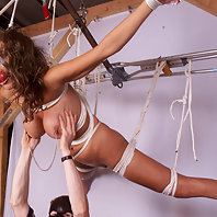 Big titted girl strung up high.