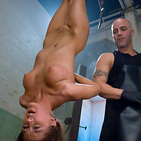 Fresh girl meat suspended and ass fucked by the butcher.