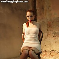 Denisa chair-tied tightly ballgagged drooling whining moaning