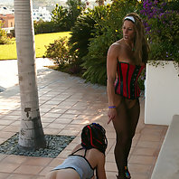 Hot bondage play at the pool and the garden outside