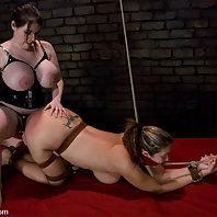 two super busty women in lesbian domination.