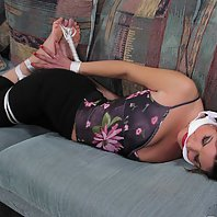 Lovely brunette slave Isabelle Rose gets tied up on the couch by a crazy dude