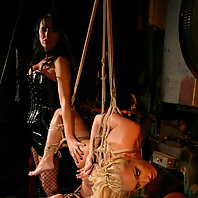 Mistress Mandy Bright is playing with candlewax