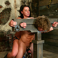 Penny Flame straps on as Mistress Penny in this hot barn shoot