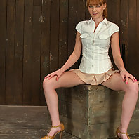 Little red girl gets bound and made to cum. Legs spread, pussy wet.