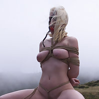 Exposed submissive girl hidden only by the fog.