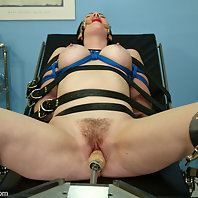 Paige is back for some bondage play in the examination room.