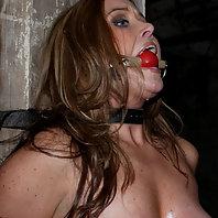 Christina Carter in steel bondage. Her toughest shoot ever.